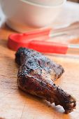 stock photo of jerk  - Barbecued chicken leg also known as Jerk Chicken  - JPG