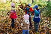 image of children playing  - An image of children playing in the autumn park - JPG