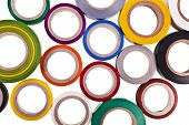 stock photo of gaffer tape  - colored circles roll of adhesive tape isolated on white background - JPG