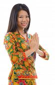 image of southeast asian  - Southeast Asian girl in a traditional greeting gesture - JPG