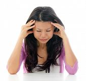 Headache Southeast Asian Chinese woman holding her head, sitting over white background