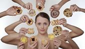 image of greed  - woman surrounded by many hands holding cream cakes with so much choice and temptation is she going to forget about her diet and indulge herself - JPG