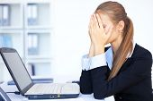 stock photo of disappointment  - Portrait of tired young business woman with laptop computer at the office - JPG