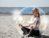 stock photo of soul  - A woman is sitting on the beach inside a bubble with peace and tranquility - JPG