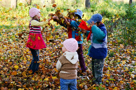 pic of children playing  - An image of children playing in the autumn park - JPG
