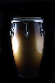 pic of congas  - A brown Latin or African conga drum isolated against a black background in the vertical format with copy space - JPG