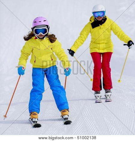 Skiing, skiers on ski run - child skiing downhill, ski lesson