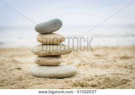 Stones Piled Up On A Sand Beach