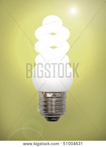 Energy Save Lamp On A Yellow Background.