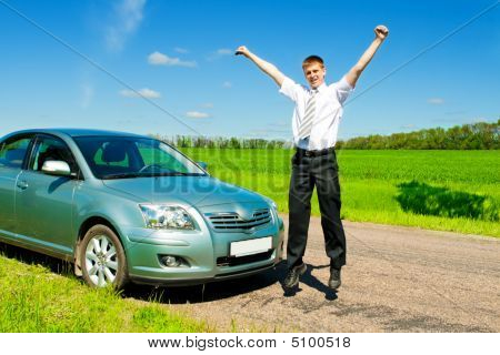Businessman Jumping Near Car