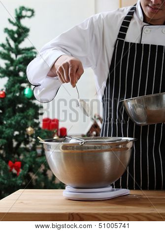 pouring the caster sugar in the mixer