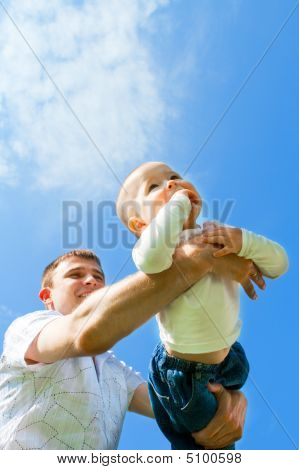 Baby Flying On Father's Hands