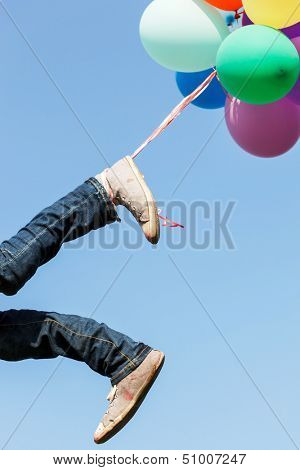 flying legs with balloons