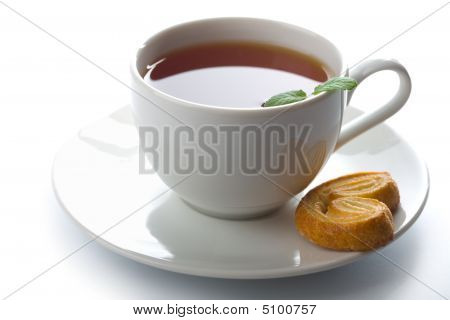 Cup Of Tea With Mint And Cookie Isolated