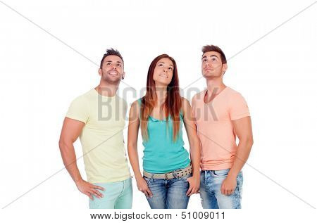 Pretty girl with two handsome boys looking up isolated on a white background