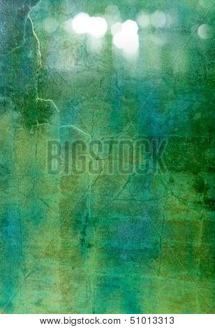 Abstract textured background: blue, green, and white patterns on dark backdrop. For art texture, grunge design, and vintage paper / border frame
