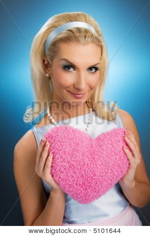 Beautiful Young Woman With Fluffy Heart Pillow