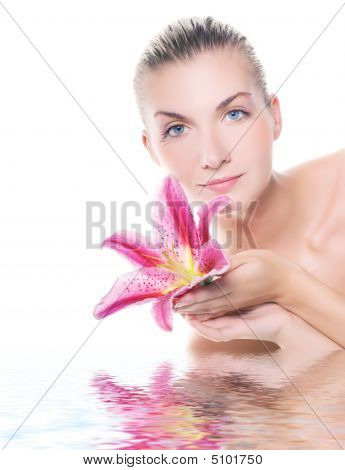 Beautiful Woman With Lily Flower Reflected In Water