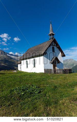 Small white church in the alps