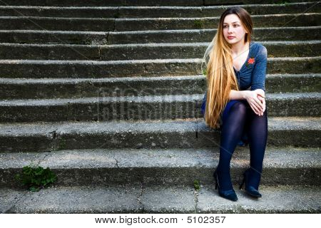 Grunge Portrait Of Pensive Beautiful Woman On Steps