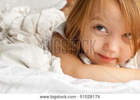 Adorable little girl laying in the morning