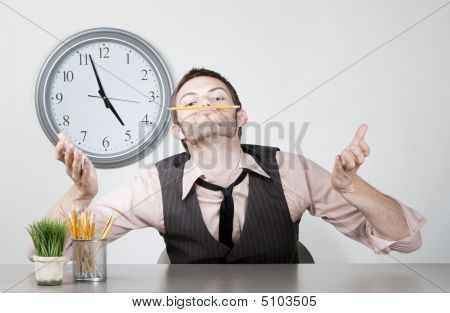 Bored Young Businessman Balancing A Pencil