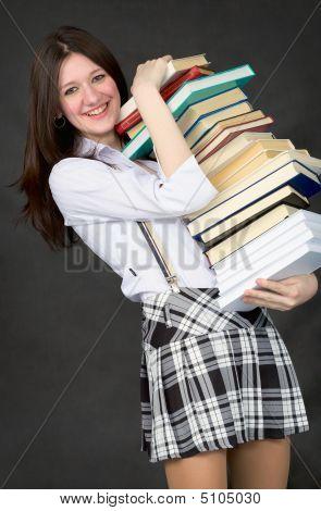 Schoolgirl Bearing Pile Of Books