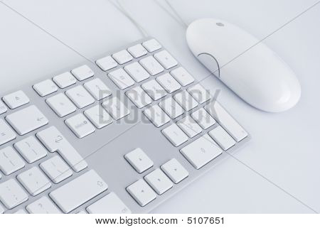 White Keyboard And A  Mouse
