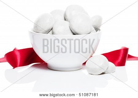 White Gingerbread Cookies In A White Bowl With A Red Ribbon