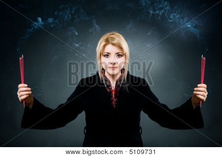 Woman With Aroma Sticks