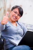 stock photo of online education  - Portrait of a young Asian woman showing her satisfaction - JPG