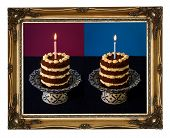 stock photo of nacked  - Chocolate birthday party nacked cake with vanilla cream and burning candle on antique ceramic stand with blue pattern purple background dark blue tablecloth golden antique carved picture frame isolated on white background - JPG