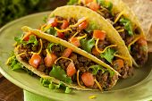stock photo of tacos  - Homemade Ground Beef Tacos with Lettuce Tomato and Cheese