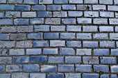 stock photo of paved road  - blue cobblestone paved street in Old San Juan Puerto Rico - JPG