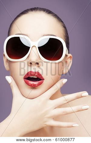 closeup portrait of young gorgeous caucasian woman wearing sunglasses