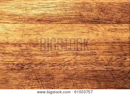 Background of an old natural wooden darken room with messy and grungy cracked tree floor of beech texture, close up vintage painted and golden warm rural interior with wood, shadows, dingy, dim light