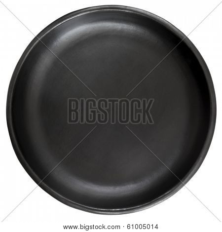 Empty black stoneware plate, isolated on white background.