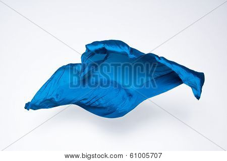 abstract pieces of blue fabric flying, high-speed studio shot
