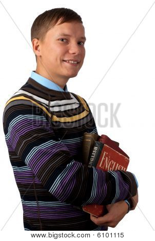 Student Smiling And Holding Books