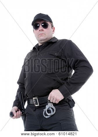 Policeman wearing black uniform and glasses standing confidently