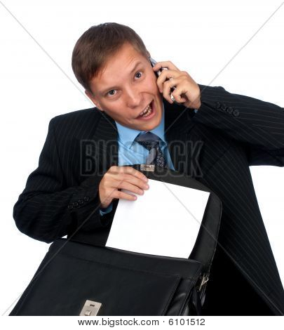 A Handsome Business Man Talking On Cell Phone