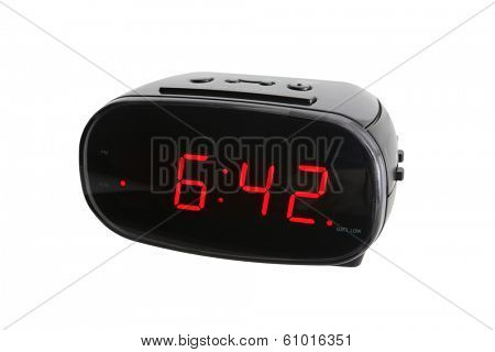 Digital alarm clock on white background