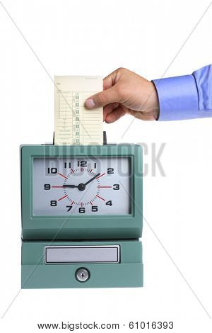 Hand putting card in time clock on white background