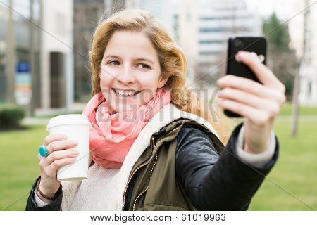 Selfie - self portrait with mobile phone
