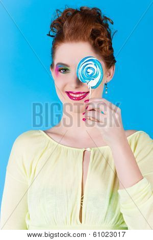 Young woman with a lollypop or lolly in Studio, she have a sweet tooth