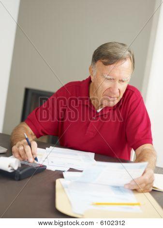Senior Man Checking Home Finances
