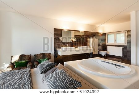 beautiful interiors of a modern house, bedroom