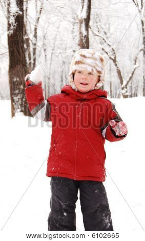 The Boy In Winter Park Plays Snowballs