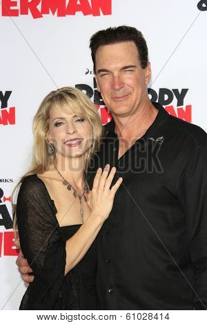 LOS ANGELES - MAR 5: Patrick Warburton, wife at the premiere of 'Mr. Peabody & Sherman' at Regency Village Theater on March 5, 2014 in Los Angeles, California