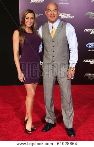 LOS ANGELES - MAR 6: Amber Miller, Tito Ortiz at the premiere of DreamWorks Pictures' 'Need For Speed' at TCL Chinese Theater on March 6, 2014 in Los Angeles, California